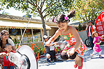Anjali Sharma, 5, jumps through a rope as her brother and mom power the a string bike during a display in downtown Los Altos hosted by The Exploratorium museum.