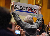 A protestor interrupts the United States Senate Committee on Foreign Relations hearing considering the nomination of Rex Wayne Tillerson, former chairman and chief executive officer of ExxonMobil to be Secretary of State of the US on Capitol Hill in Washington, DC on Wednesday, January 11, 2017.<br /> Credit: Ron Sachs / CNP