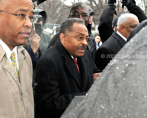 Washington, DC - January 6, 2009 -- United States Senator-designate Roland Burris (Democrat of Illinois) makes his way through a throng of media as he arrives at the United States Capitol in Washington, DC on Tuesday, January 6, 2009..Credit: Ron Sachs / CNP.(RESTRICTION: NO New York or New Jersey Newspapers or newspapers within a 75 mile radius of New York City)