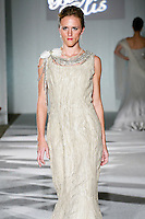 Model walks the runway in a Beth Elis Radiance wedding dress by Nere Emiko during the Wedding Trendspot Spring 2011 Press Fashion, October 17, 2010.