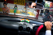 Hoardings of Bollywood movies are seen at the back of local buses in Mumbai.
