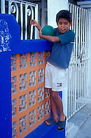 Boy in front of his house in San Miguel de Cozumel, island of Cozumel, Quintana Roo, Mexico