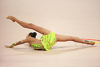 August 23, 2008; Beijing, China; Rhythmic gymnast Aliya Yussupova of Kazakhstan performs flexibility during hoop routine on way to placing 5th in the All-Around final at 2008 Beijing Olympics..(©) Copyright 2008 Tom Theobald