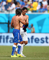 Andrea Pirlo of Italy and Edison Cavani of Uruguay exchange shirts at half time