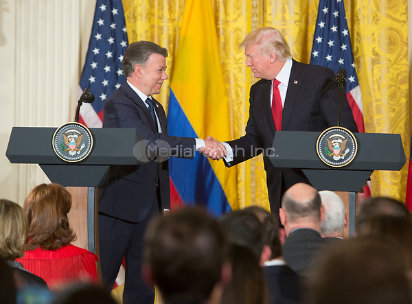 United States President Donald J. Trump shakes hands with President Juan Manuel Santos of Colombia during a joint news conference at the White House in Washington, DC, May 18, 2017. <br /> Credit: Chris Kleponis / CNP /MediaPunch