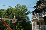 WATERBURY,  CT-051817JS02- A worker from Eversource, disconnects power lines leading to one of the four homes destroyed by fire last night on Lounsbury Street  in Waterbury on Thursday <br /> Jim Shannon Republican-American