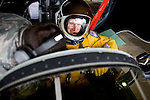"""U2 pilot Major Eric Shontz is helped into his U2 before a """"high-flight"""" at Beale Air Force Base February 24, 2010 in Linda, Calif."""