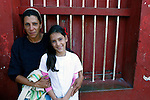 Central America, Cuba, Remedios. Cuban girl and her mother in Rememdios.