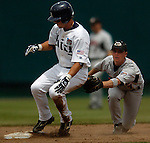 06/17/2006 Rice's Jordon Dodson slides into second base ahead of the tag by Georgia's Mathew Dunn during, game 3 of the College World Series in Omaha Nebraska Saturday afternoon.  Dodson hit a single, the second hit for Rice and advanced to second on an error.  His single knocked in the first run for rice..(photo by  /Prairie Pixel Group)