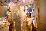 Liturgy service at St. Sava Orthodox Church, Jackson, Calif...Bringing the sacrament to the faithful from the altar.