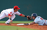Catcher Sebastian Valle (9) slides safely into second base with a double in a game against the Greenville Drive on May 13, 2010, at Fluor Field at the West End in Greenville, S.C. Applying the late tag is Drive second baseman Kenneth Roque (13).