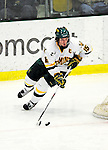 29 January 2010: University of Vermont Catamount defenseman Kevan Miller, a Junior from Los Angeles, CA, in action during the third period against the University of Maine Black Bears at Gutterson Fieldhouse in Burlington, Vermont. The Black Bears defeated the Catamounts 6-3 in the first game of their America East weekend series. Mandatory Credit: Ed Wolfstein Photo