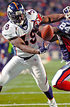 17 December 2005: Denver Broncos runningback Mike Anderson (38) bobbles the ball  momentarily, but regains control to score a touchdown against the Buffalo Bills at Ralph Wilson Stadium in Orchard Park, NY. The Broncos defeated the Bills 28-17. .Mandatory Photo Credit: Ed Wolfstein