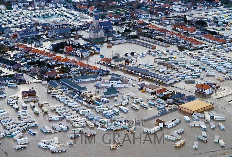 Flood disaster as caravans in a holiday caravan park float in flood water at Towyn in North Wales in 1990, UK