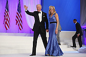 United States Vice President Joe Biden and Dr. Jill Biden wave goodbye after dancing during the Inaugural Ball at the Walter Washington Convention Center January 21, 2013 in Washington, DC. Biden and President Barack Obama started their second term by taking the Oath of Office earlier in the day during a ceremony on the West Front of the U.S. Capitol. .Credit: Chip Somodevilla / Pool via CNP