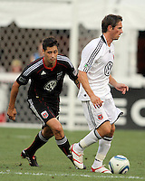 Branko Boskovic #27 of D.C. United comes up behind David Nugent #24 of Portsmouth FC during an international friendly match at RFK Stadium on July 24 2010, in Washington D.C. United won 4-0.