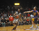 "Ole Miss guard Zach Graham (32)  dunks as Louisiana State's Matt Derenbecker (21) defends at the C.M. ""Tad"" Smith Coliseum in Oxford, Miss. on Wednesday, February 9, 2011. Ole Miss won 66-60 and is now 4-5 in the Southeastern Conference."