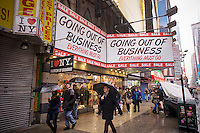 An souvenir store on Seventh Avenue in Times Square in New York on Saturday, February 23, 2013 dramatically announces that it is soon going out of business. (© Richard B. Levine)