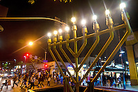 Nine flames burn on the public menorah at Santa Monica Blvd and Third Street Promenade marking the last night of Hanukkah on Saturday, December 15, 2012.