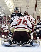 ?, Molly Schaus (BC - 30), Meagan Mangene (BC - 24) - The Boston College Eagles and the visiting University of New Hampshire Wildcats played to a scoreless tie in BC's senior game on Saturday, February 19, 2011, at Conte Forum in Chestnut Hill, Massachusetts.