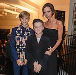 Romeo Beckham, Cruz Beckham and Victoria Beckham attend the Burberry Festive film premiere at 121 Regent Street on November 3, 2015 in London, England.© Antony Jones