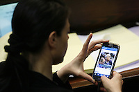 """Merav Michaeli of the """"Labour"""" party shares an instagram photo of Minister of Energy and Water Silvan Shalom, and  Minister of Strategic Affairs and International Relations Yuval Steinitz sleeping, during  plenum session voting on the state budget, in the Knesset, Israel's Parliament, in Jerusalem, late night July 29, 2013. The Knesset approved the State Budget at second and third readings in the early hours of Tuesday morning in a 58-43 vote, following a 15-hour parliamentary session. Photo by Oren Nahshon"""