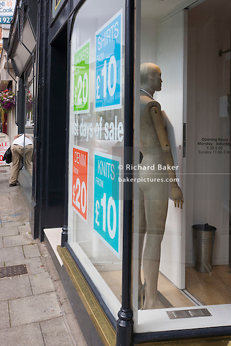 shop owner and mannequin in Bristol s Clifton district clothing shop