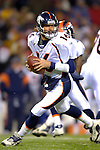 17 December 2005: Denver Broncos quarterback Jake Plummer looks to find an open receiver against the Buffalo Bills at Ralph Wilson Stadium in Orchard Park, NY. The Broncos defeated the Bills 28-17. .Mandatory Photo Credit: Ed Wolfstein