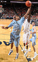 Jan. 8, 2011; Charlottesville, VA, USA;  North Carolina Tar Heels forward John Henson (31) reaches for the rebound with Virginia Cavaliers center Assane Sene (5) during the game at the John Paul Jones Arena. North Carolina won 62-56. Mandatory Credit: Andrew Shurtleff