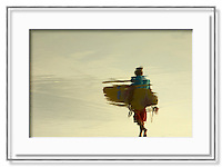 Surfer reflection on the beach Kuta Legian Beach, Bali Indonesia