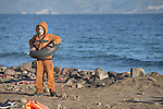 A refugee boy on a beach near Molyvos, on the Greek island of Lesbos, on November 3, 2015. He has just arrived on a boat full of refugees from Turkey. They were received by local and international volunteers, then proceeded on their way toward western Europe. The boat was provided by Turkish traffickers to whom the refugees paid huge sums to arrive in Greece.