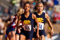 Michelle Davis hands off to Caela Wiliams for West Catholic in the High School Girls' 4x400 Philadelphia Catholic on April 22 at the Penn Relays. West Catholic won the race in  3:54.84, more than 7 seconds ahead of second-place Cardinal O'Hara.