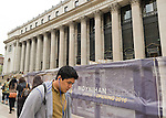 Manhattan, New York, U.S. - May 21, 2014 - Construction is underway on 8th Avenue at the James A Farley Post Office, which is the future home of Moynihan Station, during a pleasant Spring day in midtown Manhattan. Signs explain this Empire State Development project is scheduled for a Phase 1 Opening 2016.