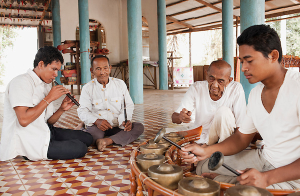 Master Ling Srei. ( Srey) and his assistant  Um Chhoeum. teach a  Kantoam Ming  class at Wat Atwea, Siem Reap, Cambodia...Kantoam Ming is funeral music with gongs, drums and a reed instrument - one of Cambodia's rarest art forms....Cambodian Living Arts works to support the revival of traditional Khmer performing arts and to inspire contemporary artistic expression. CLA supports arts education, mentorship, networking opportunities, education, career development, and income generating projects for master performing artists who survived the Khmer Rouge as well as the next generation of student ar