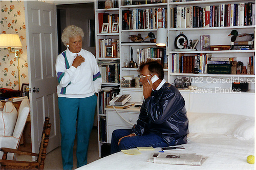 Kennebunkport, Maine - August 21, 1991 -- United States President George H.W. Bush talks with President Mikhail Gorbachev of the Union of Soviet Socialist Republics (U.S.S.R.) from his Kennebunkport, Maine home on August 21, 1991 concenring the end of the coup in the Soviet Union.  First lady Barbara Bush listens..Credit: White House via CNP