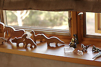 Wooden toys on a window ledge