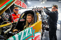 Feb 10, 2017; Pomona, CA, USA; Crew members surround the car of NHRA top fuel driver Leah Pritchett as she warms up in the pits during qualifying for the Winternationals at Auto Club Raceway at Pomona. Mandatory Credit: Mark J. Rebilas-USA TODAY Sports