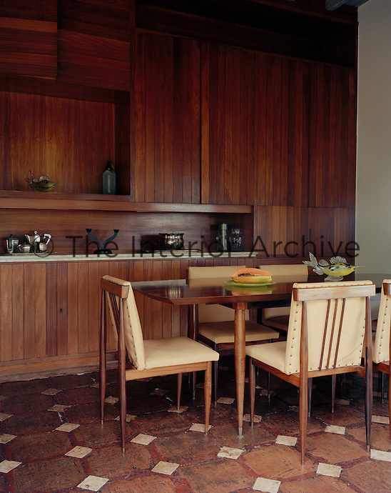 One wall of the dining room is dominated by a bespoke built-in cupboard
