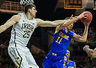 Dec. 7, 2013;  Notre Dame forward Tom Knight battles for the rebound against Delaware forward Devonne Pinkard in the first half.  Photo by Barbara Johnston/University of Notre Dame