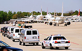 Foreign delegation airplanes and motorcades wait on the tarmac April 12, 2010 at Andrews Air Force Base in Maryland. Leaders from around the world including nuclear powers are meeting in Washington this week for a two-day nuclear security summit..Credit: Olivier Douliery / Pool via CNP