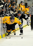 29 December 2007: Quinnipiac University Bobcats' forward David Marshall, a Junior from Buffalo, MN, is tripped up by Western Michigan University Broncos' right wing forward Matt Clackson, a Junior from Pittsburgh, PA, during a game at Gutterson Fieldhouse in Burlington, Vermont. The Bobcats defeated the Broncos 2-1 in the first game of the Sheraton/TD Banknorth Catamount Cup Tournament...Mandatory Photo Credit: Ed Wolfstein Photo