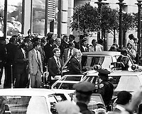 President Gerald Ford exits the St. Francis Hotel in San Francisco. (seconds after this photo was snapped a woman, Sara Jane Moore in the crowd across the street fired a shot. Ford was not hit)......photo copyright 1975 Ron Riesterer)