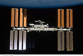 In Earth Orbit - July 28, 2009 -- Backdropped by the blackness of space and Earth's horizon, the International Space Station is seen from Space Shuttle Endeavour as the two spacecraft begin their relative separation. Earlier the STS-127 and Expedition 20 crews concluded 11 days of cooperative work onboard the shuttle and station. Undocking of the two spacecraft occurred at 12:26 p.m. (CDT) on July 28, 2009. A partial shadow of Endeavour is visible on the solar array wing panels..Credit:  NASA via CNP
