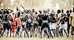 Every Dinka male is a warrior. In this photo, these young men group together at an annual gathering to select a new song for their warrior &quot;age-set.&quot;  Freedom Square, Rumbek, South Sudan.