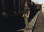 A U.S. Border Patrol agent in Del Rio, Texas scans the early morning  train for illegal aliens headed north to San Antonio. While the traditional mission of the United States Border Patrol has always been the detection and prevention of the illegal entry of aliens and smuggling of illegal contraband into the United States anywhere other than a designated port-of-entry, the dawn of the age of terrorism within our nation has added a new and high priority mission: to detect and prevent the entry of terrorists and their weapons into the United States. Jim Bryant Photo..©2006. All Rights Reserved.