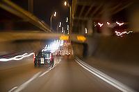 Traffic speeds through the lower deck of I-35 corridor in downtown Austin, an underground maze of highways and interchanges.
