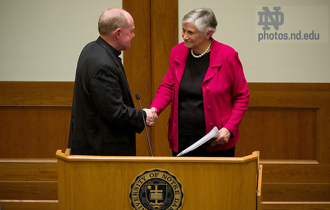 """April 10, 2012; Rev. Timothy R. Scully, C.S.C., Director, Institute for Educational Initatives, shakes hands with Diane Ravitch, Research Professor of Education at New York University, after her address, titled """"Is There a Crisis in Public Education?"""" as part of the Forum 2011-12: Reimagining School in Notre Dame Law School's McCartan Courtroom. Photo by Barbara Johnston/University of Notre Dame"""