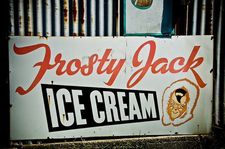 Tin 'Frosty Jack' icecream sign on a corregated wall at Bainham Store, Golden Bay, South Island, New Zealand - stock photo, canvas, fine art print