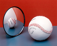BASEBALL REFLECTED IN CONVEX MIRROR<br /> Light Rays Diverge Forming A Virtual Image<br /> The image appears to form behind the mirror as virtual, erect, and reduced in size.