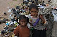 Young girls collecting garbage in Bhaktapur, Layaku Nepal